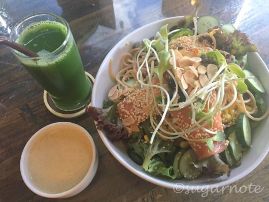 Salmon Salad with tofu dressing and fresh juice at The Salad Concept